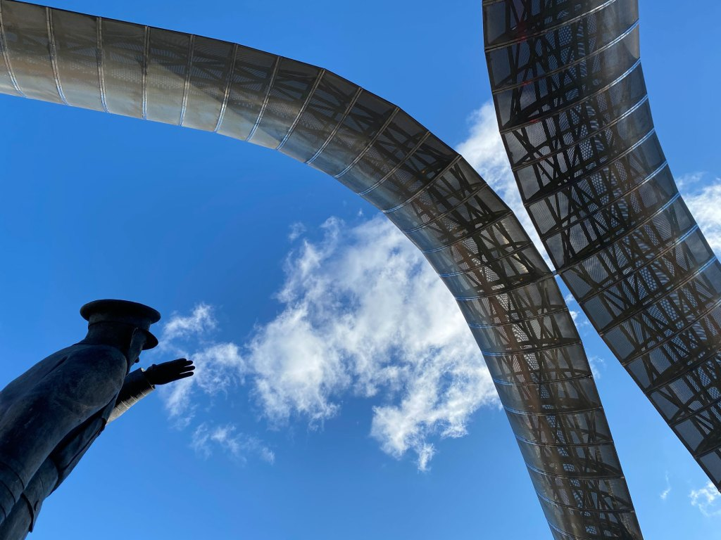 Frank Whittle blows clouds onto the monument
