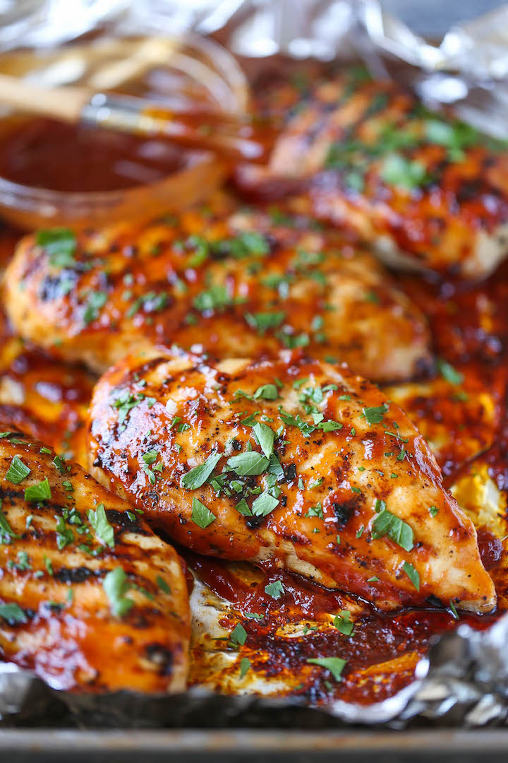 BBQ Chicken Breasts - The most tender, juicy chicken grilled to PERFECTION, smothered in a thick, homemade BBQ sauce. You can also make this ahead of time!