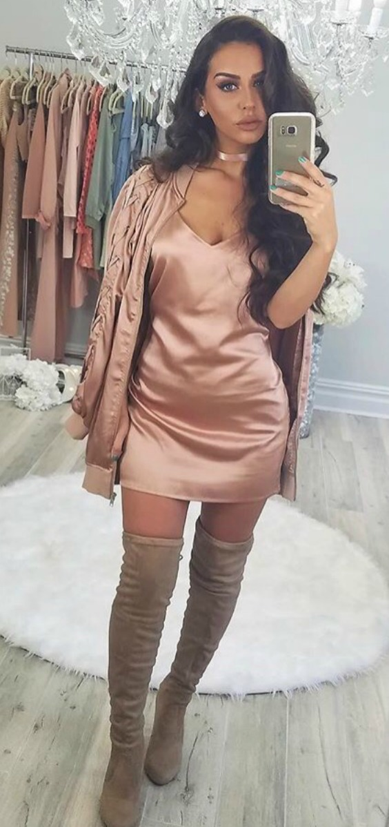 Youtuber Carlibybel wearing a rosegold missguided bomber jacket and a silk missguided rosegold dress with thigh high boots