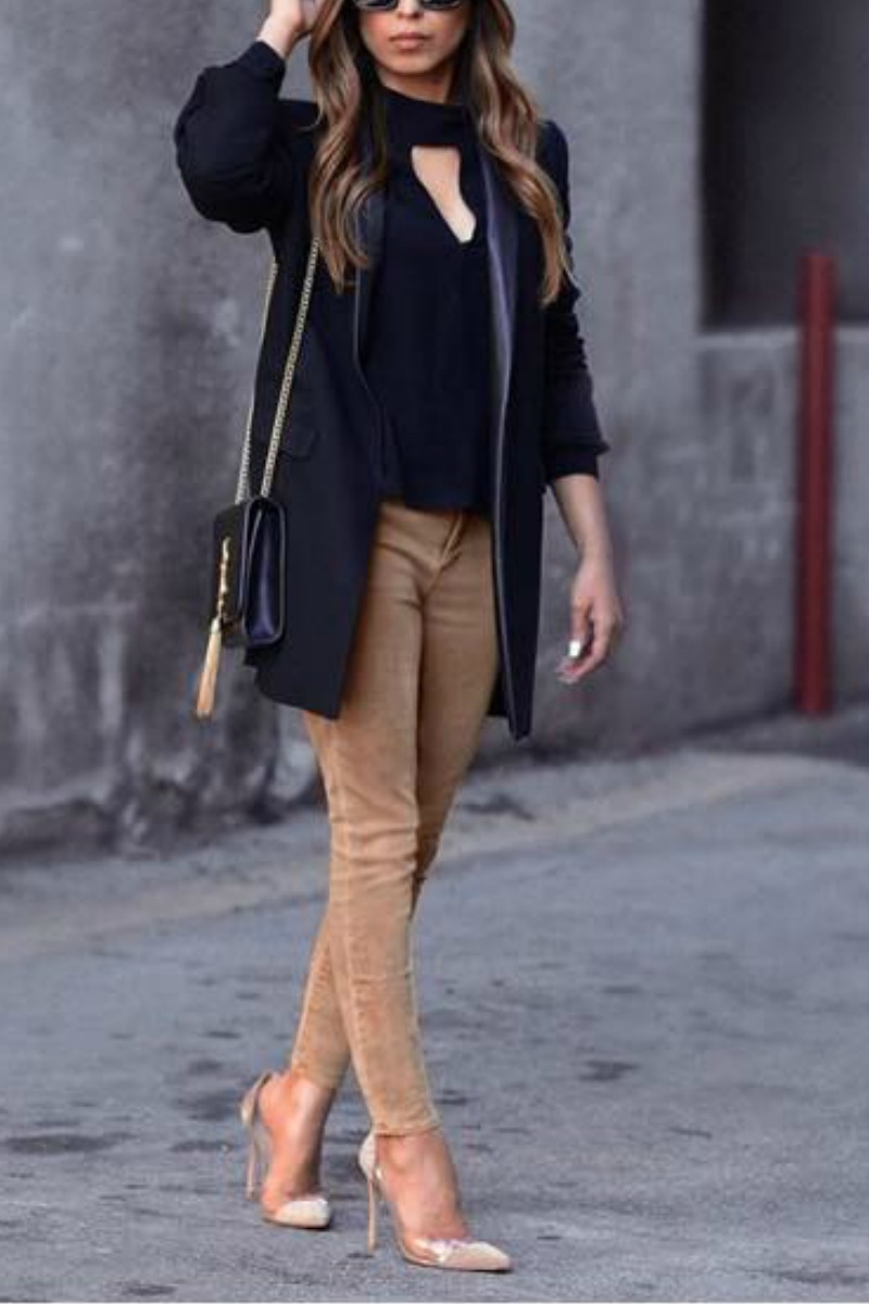 trendy office outfit with brown jeans nude pumps a black blazer and ysl bag