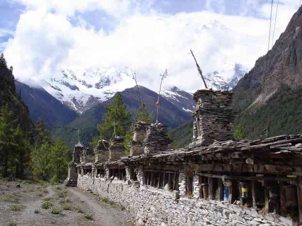 A set of prayer wheels with an amazing backdrop