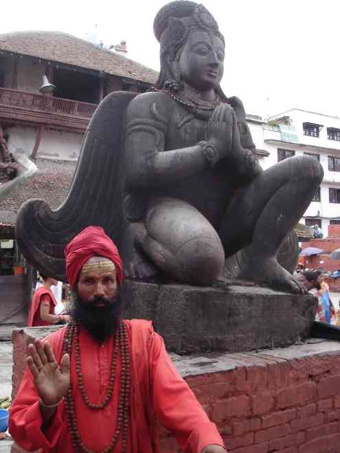 A sadhu poses in front of Garuda (for a little baksheesh of course)
