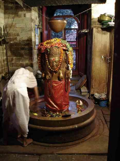 A priest maintains a stunning Shiva linga