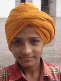 A confident, young Punjabi boy