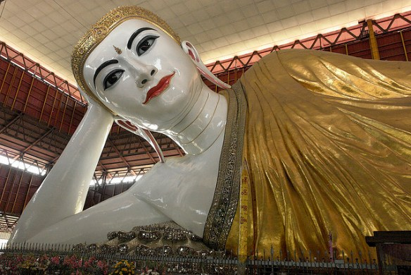 The Giant Reclining Buddha Statue close to Shwedagon Pagoda, Myanmar. Photograph by Marina & Enrique via Flickr.