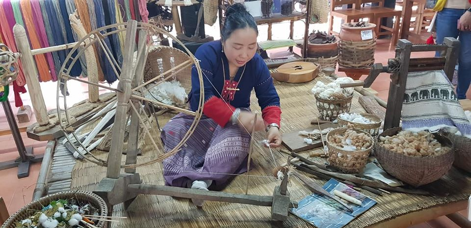 A lady demonstrates practices from traditional Thailand