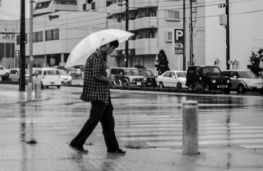 A man walked under the rain with an umbrella, Naha City
