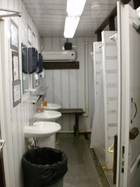 An interior shot of a typical trailer, looking towards the sinks & showers