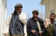 Three Afghan men at the DAIL compound
