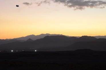 lights of FOB Lagman in the sunrise