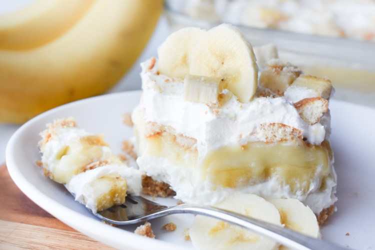 Piece of Banana Pudding Dessert with a fork being taken out of it