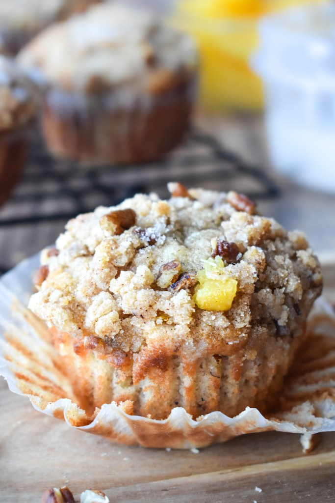 Peach Muffin with muffin wrapper being pulled off