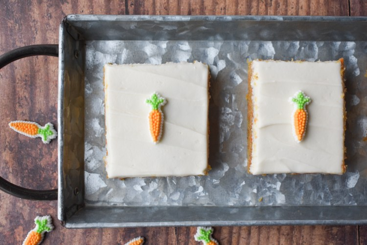 Carrot Cake Sheet Cake slices on a metal tray