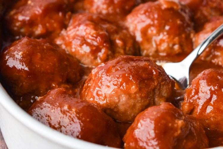 White casserole dish with ham balls