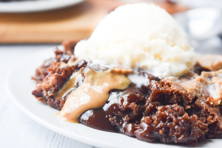 Chocolate Peanut Butter Cobbler with a scoop of ice cream on top