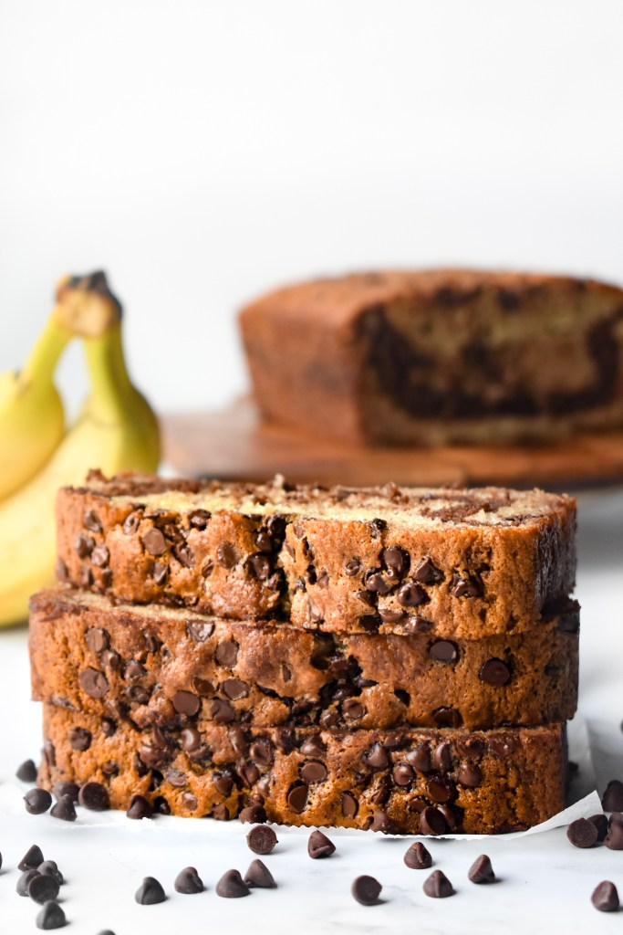 Three slices of chocolate chip banana bread in a stack.
