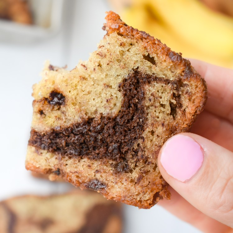 Chocolate chip banana bread with a bite taken out of it