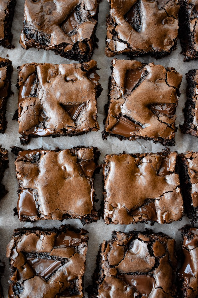 cut brownies on parchment paper