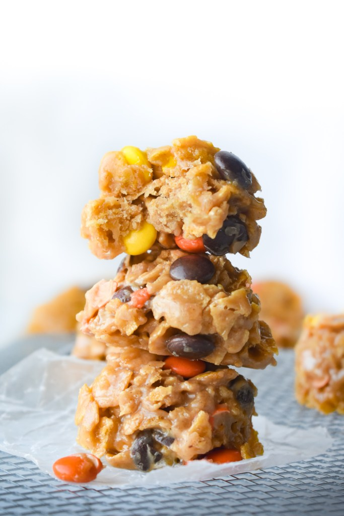 No Bake Peanut Butter Treats on parchment paper in a stack