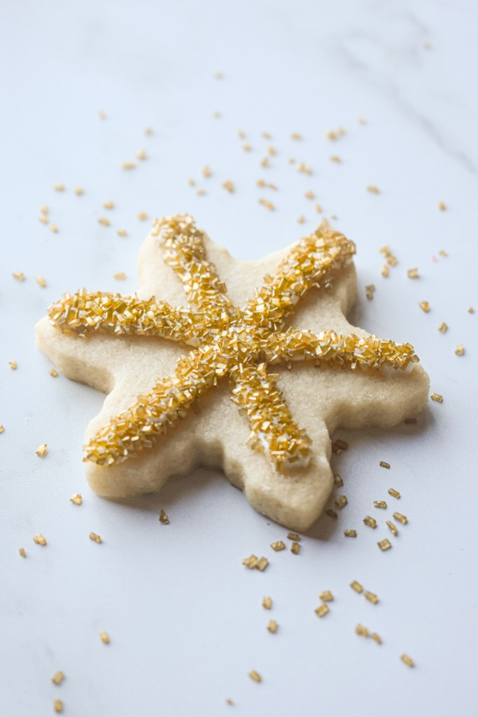 Snowflake cut-out cookie with gold sprinkles