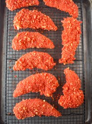 Flamin Hot Cheeto Chicken Strips on a pan