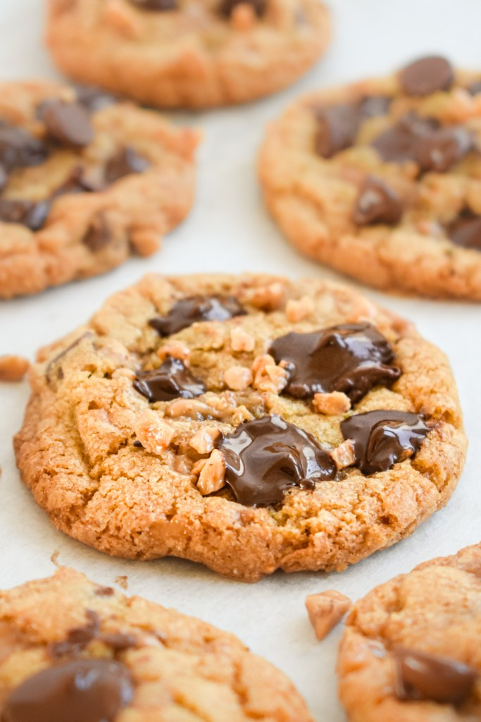Toffee Chocolate Chip Cookie on a sheet of parchment paper
