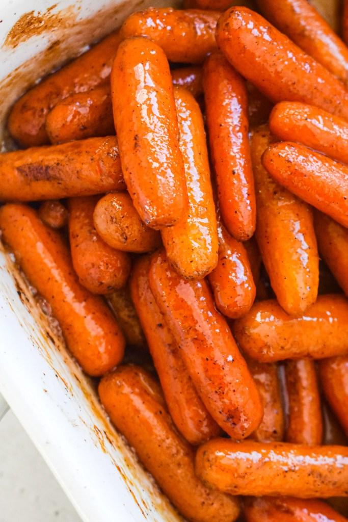 Glazed carrots in a white casserole dish