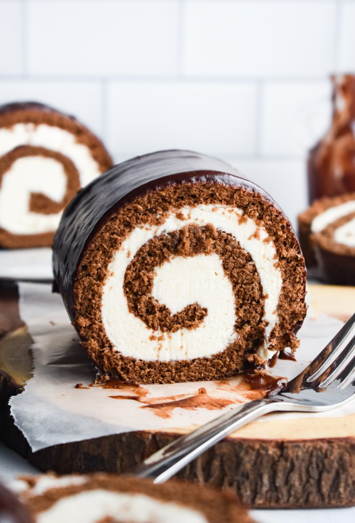 Swiss Roll Cake cut down the middle with a fork next to it