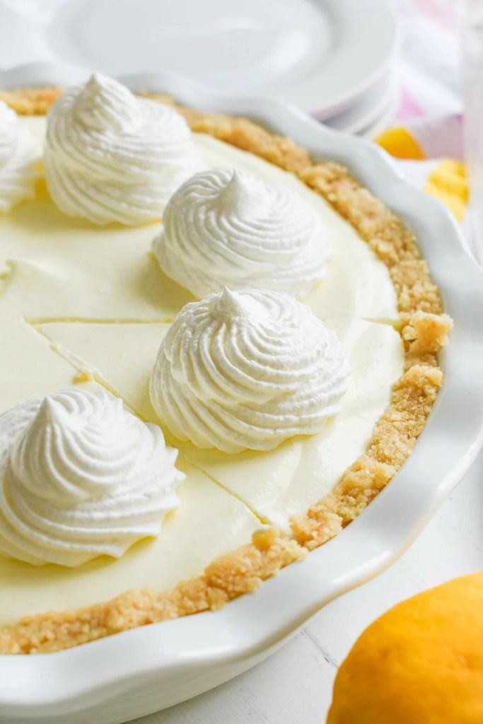 Creamy Lemon Pie in a white pie plate