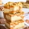 pumpkin cheesecake bars in a stack