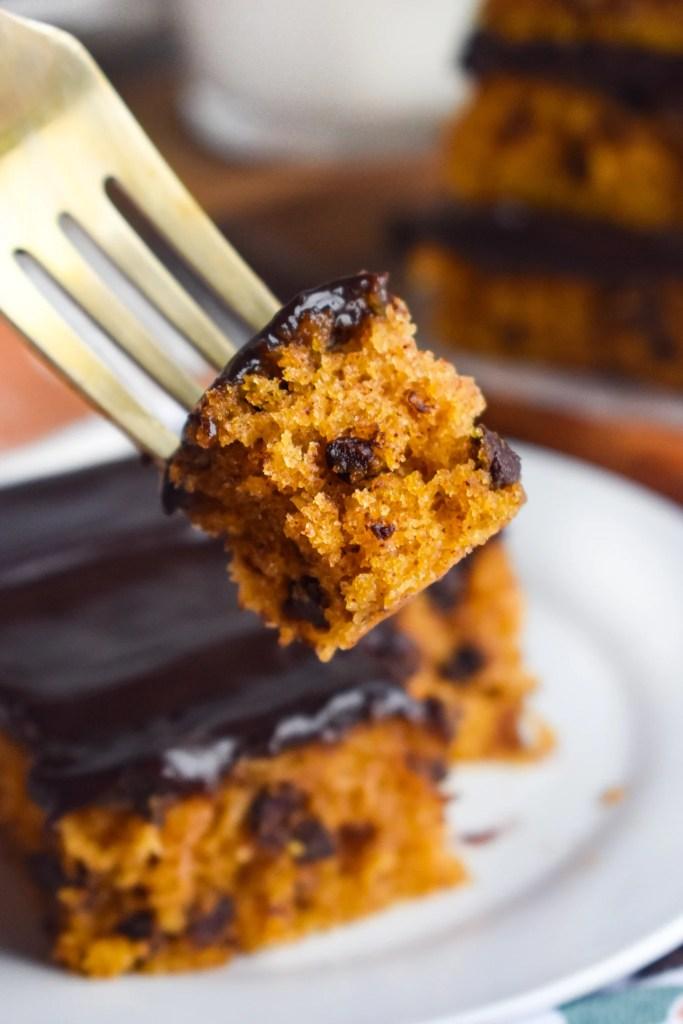 bite of a pumpkin chocolate chip bar on a gold fork
