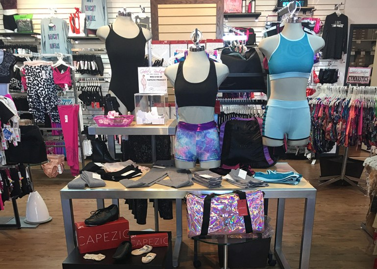 Dance retail display: Nested tables with dance leotards, bra tops, shorts and dance shoes at Gabie's Boutique in Newmarket, ON, Canada