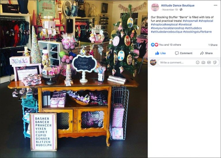 Facebook post with photo of display of dancewear gifts on a table at Attitude Dance Boutique, with #shoplocal hashtag in the post.
