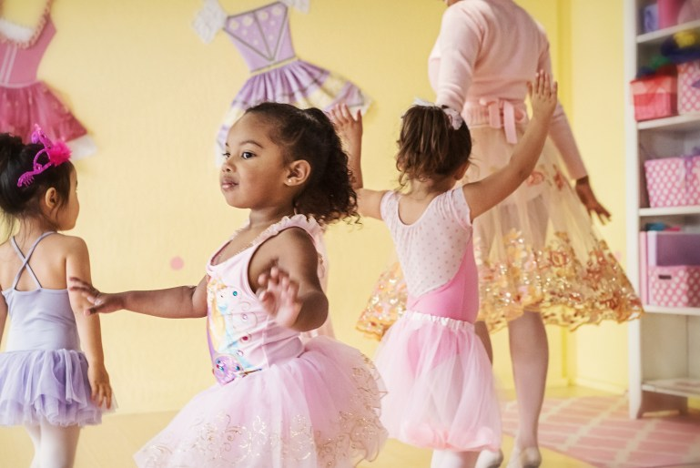 Three tiny dancers with their teacher during a lesson at a Tutu School.