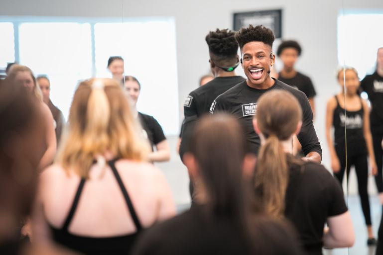 Robert Hartwell, founder of The Broadway Collective, working with a group of dance students.
