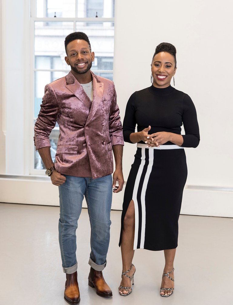 Nigel Campbell, in a pink jacket and jeans, and Chanel DaSilva, in a black and white dress, founders of MOVE|NYC|, standing in a studio