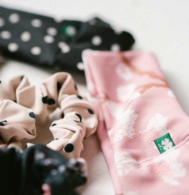 Headbands in pink and black and white polka dots, plus scrunchies, made by Luckyleo Dancewear