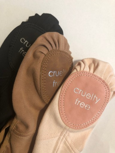 """Cynthia King's vegan ballet shoes in three colors—black, brown and pink. The soles say """"cruelty free."""""""
