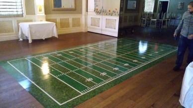 Dance floor with a football field wrap