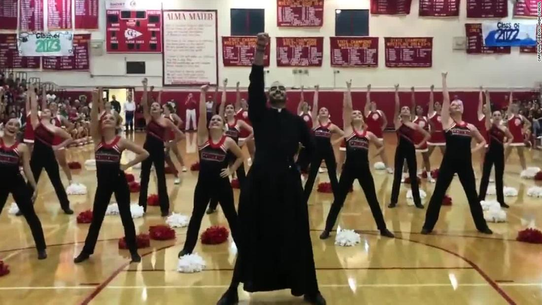 Dancing priest wows students at pep rally