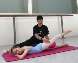 Marie Walton-Mahon with a student in a Progressing Ballet Technique course. Photo courtesy of Walton-Mahon.