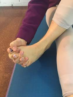Toe and finger handshake.