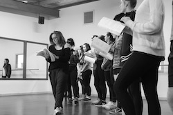 Kelly Aykers and students in rehearsal.