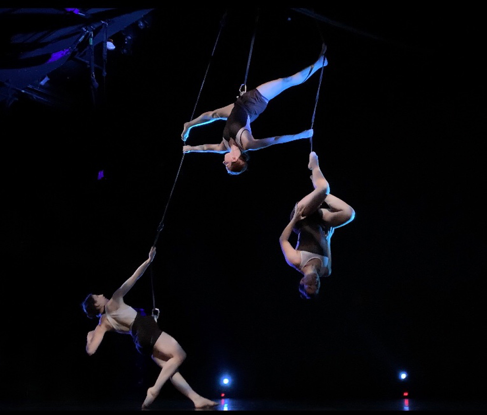 """""""Stacked"""" featuring dancers Alanna Kletcke, Dani Bitout and Libby Westra. Choreography by Chloe Jensen. Lighting Design by Shelbi Arndt."""