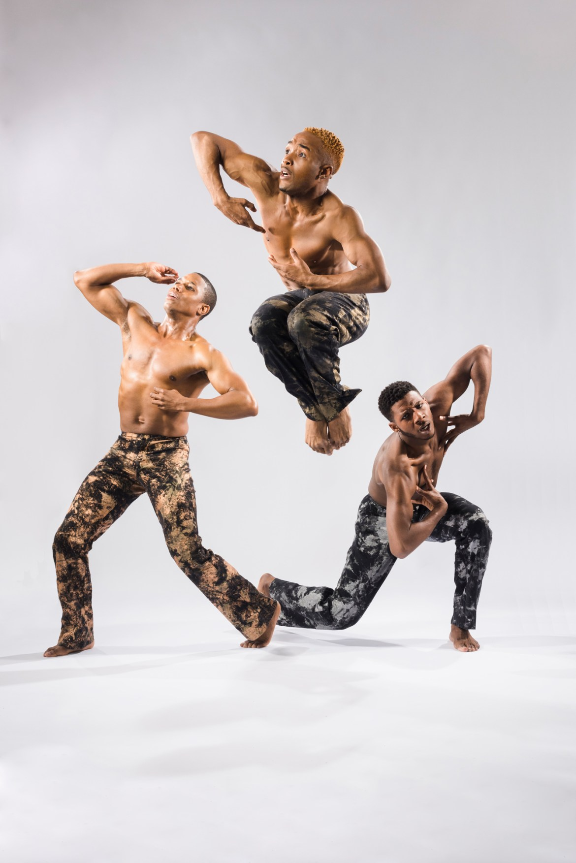 "Deeply Rooted Dance Theater's Pierre Clark, William Roberson and Joshua Henry in Joshua L. Ishmon's ""When Men"" (Photo by Ken Carl)"