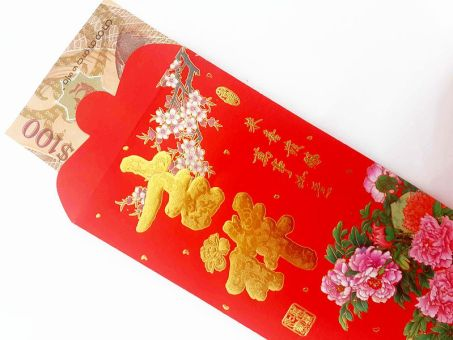 Chinese New Year is a time to gift coins to friends and family in a red envelope.