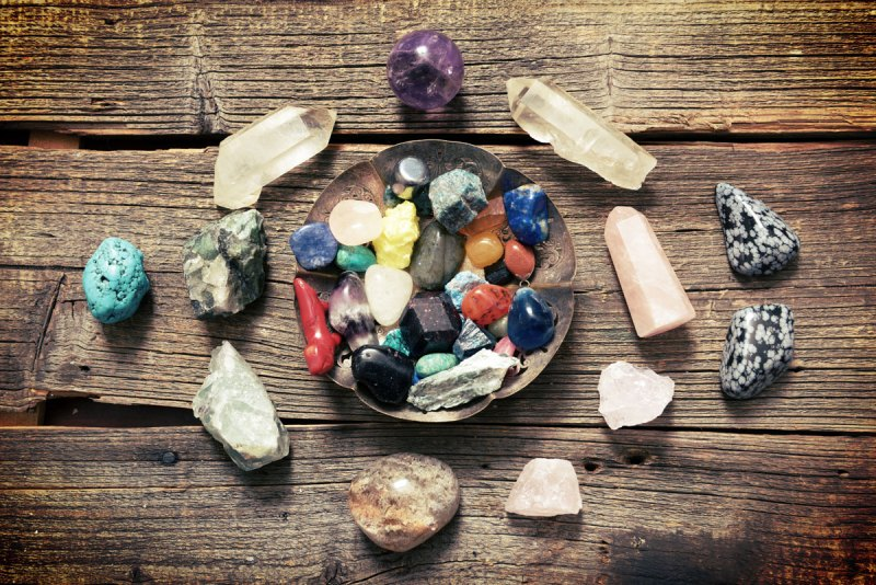 Healing crystal grid with a bowl full of crystals in the center.