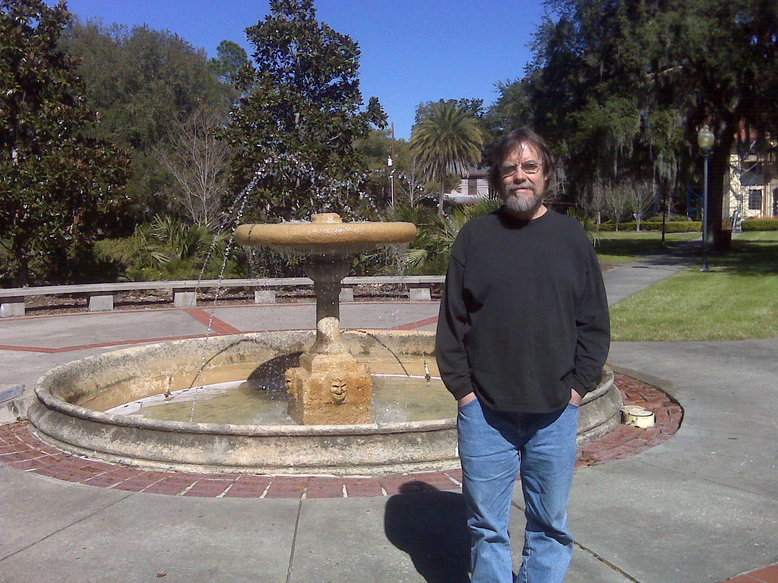 Greg in front of the Thomas Center fountain