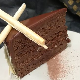 Chocolate Cake with peanut Gianduja and cherry syrup, garnished in rare Guatemalan white chocolate.