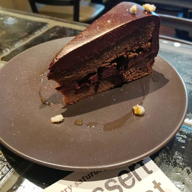 CHOCOLATE CAKE - Tanriva caramel sponge with apricot ganache, dried cherries and tangerine for dessert Night tonight 7 pm to 10 pm!#chocolatier #dessertnight #cake #valrhona #apricot #fromscratch